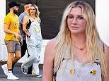Kesha wears happy face buttons while taking a stroll with a mystery man in New York City