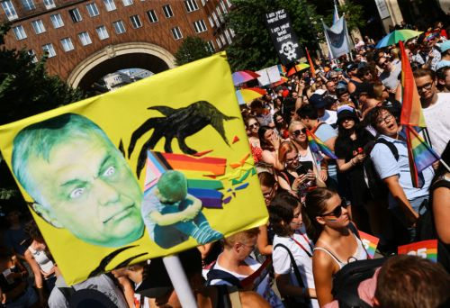 Thousands defy Orbán with festive Pride parade backing gay rights in Hungary