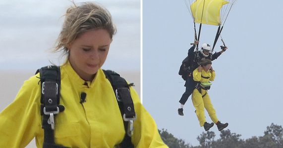 I'm A Celebrity's Emily Atack pictured crashing into camp as she parachutes out of helicopter for first trial