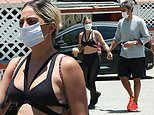 Lady Gaga masks up and holds hands with boyfriend Michael Polanksy during coffee run in Los Angeles