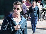Hugh Jackman relaxes at a seaside cafe in Perth as he takes a break from his global one-man show