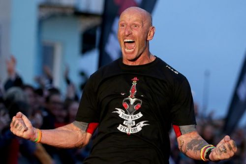 Rugby star Gareth Thomas finishes gruelling 140-mile Ironman after revealing he's HIV positive