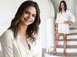 Samantha Harris flaunts her impressively long legs in a white mini-dress at a wine launch in Sydney