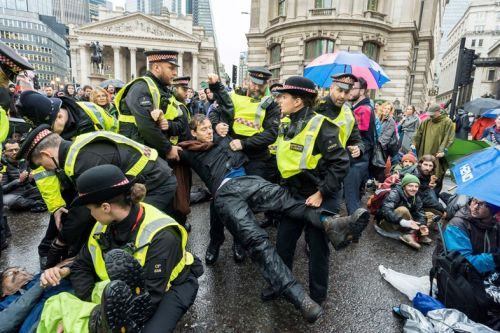 Extinction Rebellion defies police ban by continuing London protests