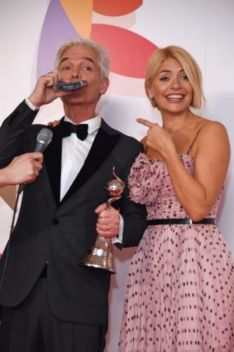NTAs 2019: Holly Willoughby and Phillip Schofield drink from HIP FLASK backstage as pair celebrate This Morning win