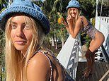 Elyse Knowles shows off her figure in a leopard print swimsuit