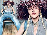 Madonna evokes her western-inspired Don't Tell Me getup in denim overalls and an artsy straw hat