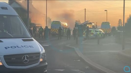 Cop van set on fire as yobs attack officers and throw bricks in Leeds