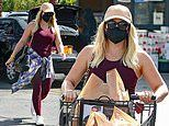 Hilary Duff makes a splash in burgundy workout gear as she steps out for groceries in Beverly Hills