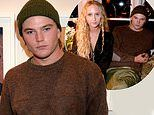 Jordan Barrett cuts a casual figure as he attends a LFW event with model Elfie Reigate
