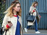 Lily James nails low-key glam in Burberry trench coat and jeans following All About Eve performance