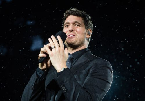 Michael Bublé fights back tears as he returns to the stage in London after son's cancer battle