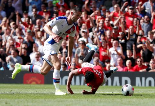 Man Utd fans fume as Cahill escapes red card for Crystal Palace after foul on Martial