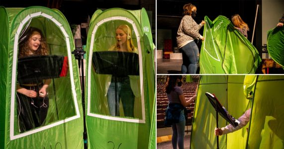 School band holds rehearsals with each member isolating in green pop-up tents