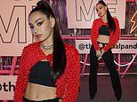 Charli XCX showcases her taut abs in black cutout chaps as she performs at the Pandora ME launch