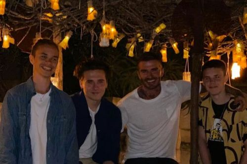 Victoria Beckham hits beach bar with David and lookalike sons on Miami break
