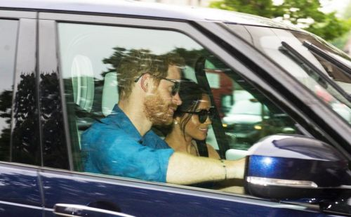 Prince Harry and Meghan arrive back at Kensington Palace in first picture after Royal Wedding