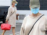 Katy Perry sports an oversized sweatshirt dress in Beverly Hills after returning from Capri holiday