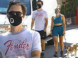 Zach Braff and Florence Pugh take their dog for a walk as they continue to honor Nick Cordero