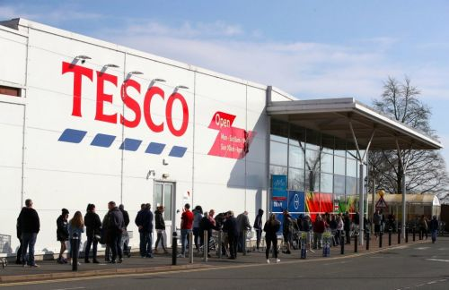 Tesco limits online orders and asks people to go to the shops as panic buying continues