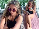Jade Thirlwall sunbathes and drinks a cocktail in her flat to tease Little Mix's new song Holiday