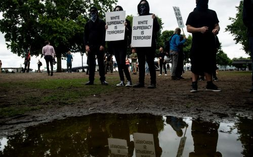 Police seize weapons as Portland braces for clashes between far-right and antifa protesters