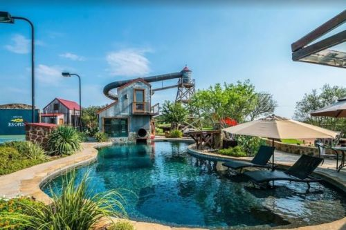 You can book an amazing holiday home with a private pool, huge waterslide and hot tub
