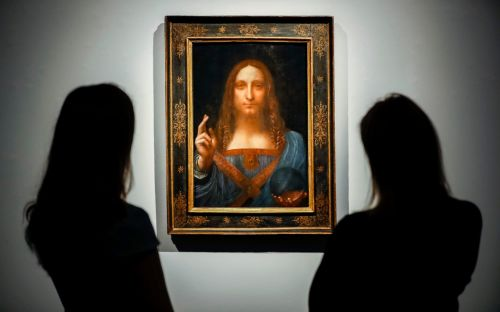 Louvre intervenes in Leonardo Da Vinci row as author claims Paris gallery has said it will not refer to Salvator Mundi as being by the artist