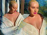 Christina Aguilera exposes cleavage in her bathrobe during 'cozy and calm' Memorial Day Weekend