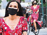 Famke Janssen is radiant in red as she enjoys the beautiful New York City weather on a bike