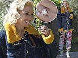 Gwen Stefani beams as she flashes $500K engagement ring after leaving a friend's house