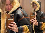 Lara Bingle poses in her new $12,000 Louis Vuitton leather jacket