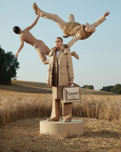Burberry models fly through fields of wheat