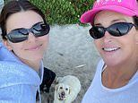 Caitlyn Jenner and daughter Kendall Jenner smile for a beach selfie with the dogs