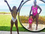 Serena Williams shows off her booti-licious assets in a white swimsuit as she raises arms to the sky