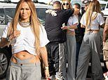 Jennifer Lopez wears drop-waist trousers with THONG peeping out the top on set of music video