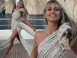 Heidi Klum exudes glamour as she twirls on her yacht wearing a dazzling couture gown