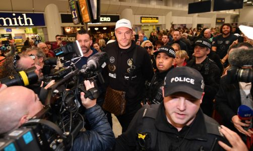 Tyson Fury arrives at Manchester airport surrounded by cops with Paris wearing world title belt after Deontay Wilder win