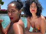 Tracee Ellis Ross, 48, flaunts her age-defying figure in a floral bikini while hanging by the pool