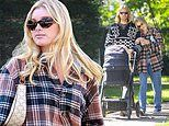 Elsa Hosk snuggles up to her boyfriend Tom Daly during relaxing stroll with baby daughter Tuulikki