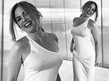 Smiling Isla Fisher is a vision in white in stunning one-shoulder dress in latest social media post