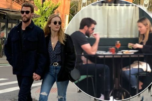 Liam Hemsworth and Maddison Brown hold hands as they're seen together for first time