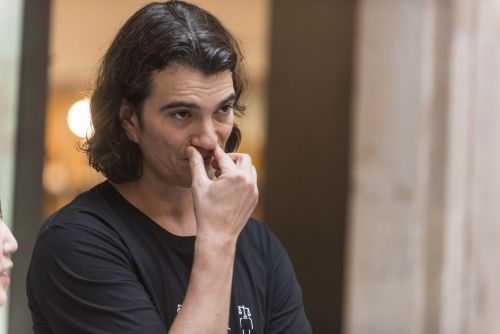 WeWork's chairman said Adam Neumann 'may have violated' the terms of his $185 million consulting contract with his former company, and that it's is no longer in effect