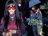 Rihanna rocks a camouflage skirt over matching pants as her bodyguard CARRIES her into a party in NY