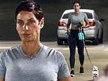 Nicole Murphy shows off sculpted figure as she walks Maltese pooch during Tiffany's shopping trip