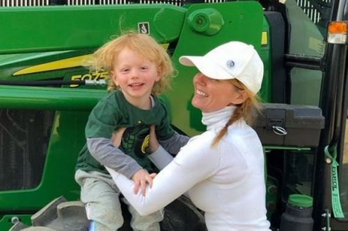 Geri Halliwell cuddles son as they ride tractor on her sprawling country estate