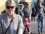 Ali Fedotowsky enjoys a visit to the Farmers Market with husband Kevin Manno and their two children
