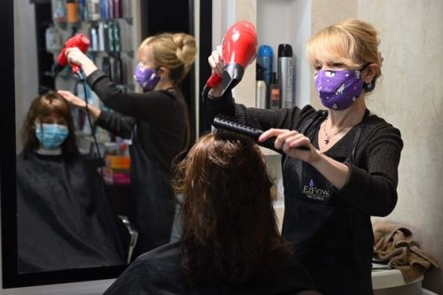 Hairdressers will not open before July 'at the earliest', government confirms