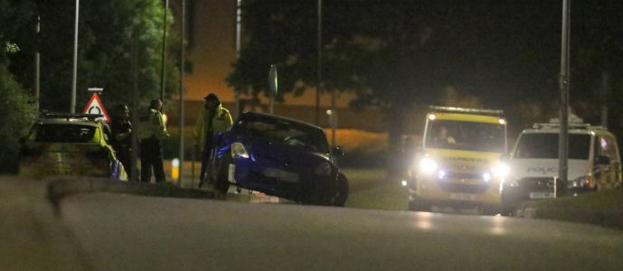 Crash leaves 14 injured as people are hit at side of road during car meet