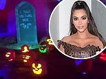 Kim Kardashian gets into the Halloween spirit as she takes in some spooky decor with her kids